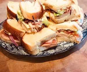 Small assorted sandwich platter on fresh country white bread.